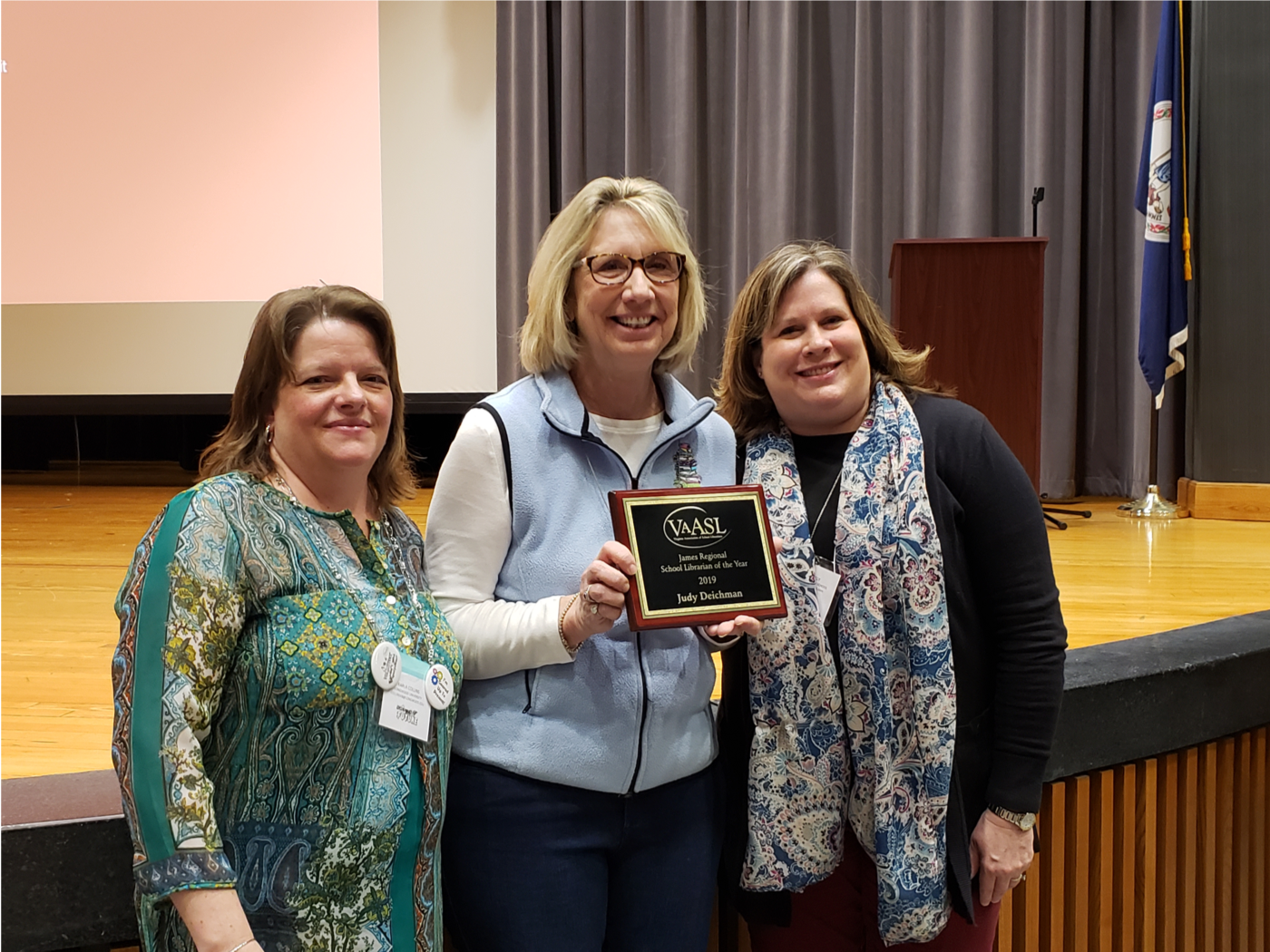 Judy Deichman receiving the VAASL James Regional Librarian of the Year Award
